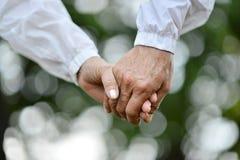 Руки, который держат совместно Стоковое Изображение RF