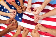 Руки международных людей показывая большие пальцы руки вверх стоковое фото