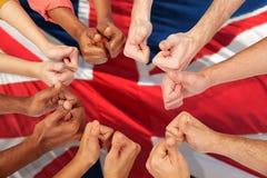Руки международных людей показывая большие пальцы руки вверх стоковое фото rf