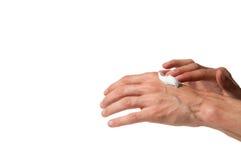 Руки мужчины работая положили дальше сливк рук изолировано Стоковые Изображения RF