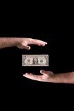Руки около долларовой банкноты Стоковое Изображение RF