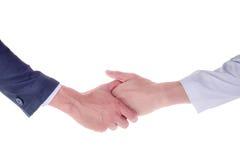2 руки около для того чтобы трясти руки, на белой предпосылке Стоковая Фотография RF