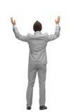 Руки повышения бизнесмена вверх от задней части стоковые фотографии rf