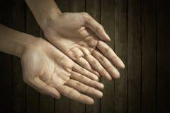 Руки приданные форму чашки совместно Стоковые Фото
