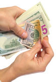 Руки при изолированные доллары, сохраненные контуры Стоковые Фотографии RF