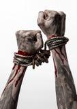Руки прыгают, кровопролитные руки, грязь, веревочка, на белой предпосылке, изолированный, похищая, зомби, демоне Стоковое фото RF