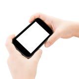 Руки ребенка держа умный телефон стоковая фотография rf