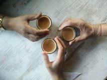 Руки старые и молодые Стоковые Фото