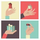 Руки с подарками Стоковое Изображение