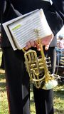 Руки трубы нося музыканта и книги песни в событии, концерте, или выставке Стоковая Фотография