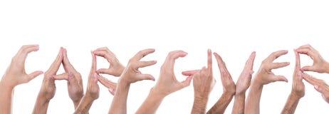 Руки формируют попечителя слова Стоковое фото RF