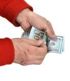 Руки человека подсчитывая деньги наличных денег доллара Стоковая Фотография