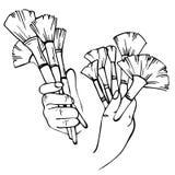 Руки эскиза визажиста с щетками Стоковая Фотография RF
