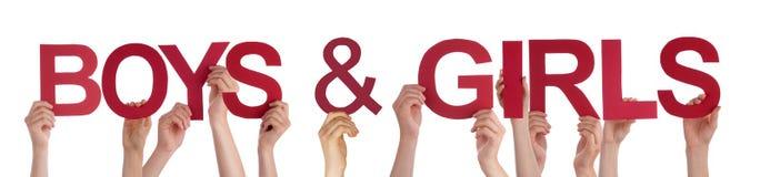 Руки людей держа красных прямых девушек мальчиков слова Стоковое Изображение