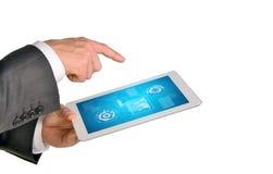 Руки Businessmans держа таблетку Стоковые Фото