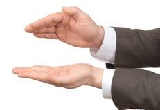 Руки Businessmans с пустым космосом на белизне Стоковые Изображения