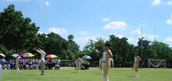 Руководители приветственного восклицания студента в Азии Стоковые Фото