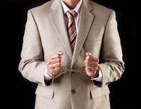 Руководитель бизнеса в наручниках - корпоративное очковтирательство Стоковые Изображения