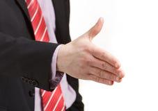 Рукопожатие бизнесмена предлагая на белой предпосылке Стоковое Изображение RF