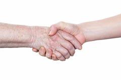 Рукопожатие пожилых женщины и детеныша Стоковые Фото