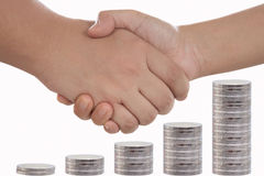 Рукопожатие с деньгами Стоковая Фотография
