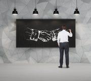 Рукопожатие чертежа бизнесмена Стоковое Фото