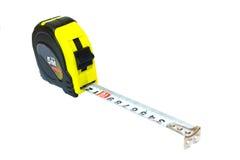 рулетка измерения удерживания руки Стоковые Изображения RF