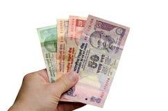 Рупии в руке стоковая фотография rf
