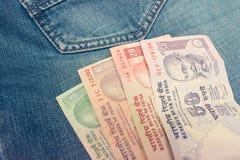 Рупии денег в джинсах стоковое изображение