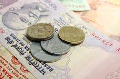 Рупии и монетки Iindian Стоковая Фотография RF