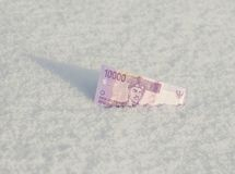 10 рупий тысяч индонезийских от снега Концепция Стоковое Фото