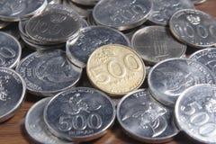 Рупия монетки - индонезийские деньги Стоковая Фотография