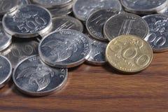Рупия монетки - индонезийские деньги Стоковая Фотография RF