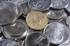 Рупия монетки - индонезийские деньги Стоковое фото RF