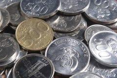 Рупия монетки - индонезийские деньги Стоковые Фото