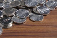 Рупия монетки - индонезийские деньги Стоковые Изображения RF