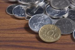 Рупия монетки - индонезийские деньги Стоковое Изображение
