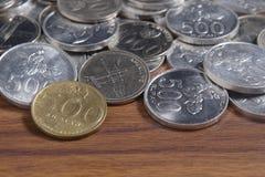Рупия монетки - индонезийские деньги Стоковые Изображения