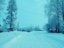 Русская деревня в сезоне зимы Стоковое Изображение