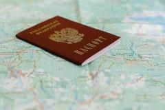 Русский пасспорт на туристской карте Стоковое фото RF