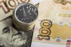 Русский рубль на фоне банкнот Стоковые Фото