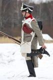 Русский солдат очищает jackboot Стоковые Фото