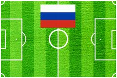 Русский флаг на предпосылке футбольного поля Стоковая Фотография