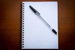 Ручка и блокнот Стоковые Изображения