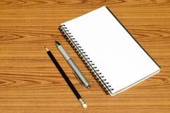 Ручка и карандаш тетради Стоковое Изображение