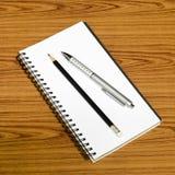 Ручка и карандаш тетради Стоковое Фото