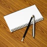 Ручка и карандаш тетради Стоковые Изображения RF