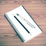 Ручка и карандаш тетради Стоковые Фотографии RF