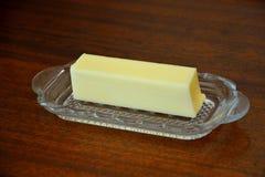 Ручка масла в блюде масла Стоковые Фотографии RF