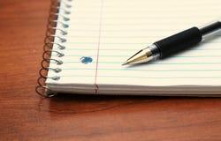 Ручка на блокноте Стоковая Фотография RF